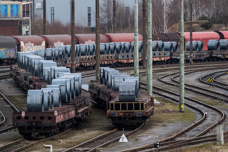 DUISBURG, GERMANY - MARCH 05: Coils of steel stand on trains in front of the ThyssenKrupp steel mill on March 5, 2018 in Duisburg, Germany. Tensions between U.S. President Donald Trump and the European Union are rising after Trump announced he would respond to any E.U. tariffs on American goods with U.S. tariffs on European cars. Trump originally sought tariffs on imports of steel and aluminum, to which EU officials said they would respond with tariffs on U.S. jeans, motorcycles and bourbon. The European Union and Canada are the two biggest exporters of steel to the United States. (Photo by Lukas Schulze/Getty Images)