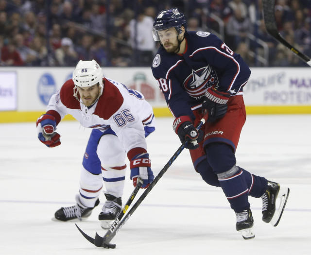 Montreal Canadiens' Andrew Shaw, left, and Columbus Blue Jackets' Oliver Bjorkstrand, of Denmark, chase a loose puck during the second period of an NHL hockey game Thursday, March 28, 2019, in Columbus, Ohio. (AP Photo/Jay LaPrete)