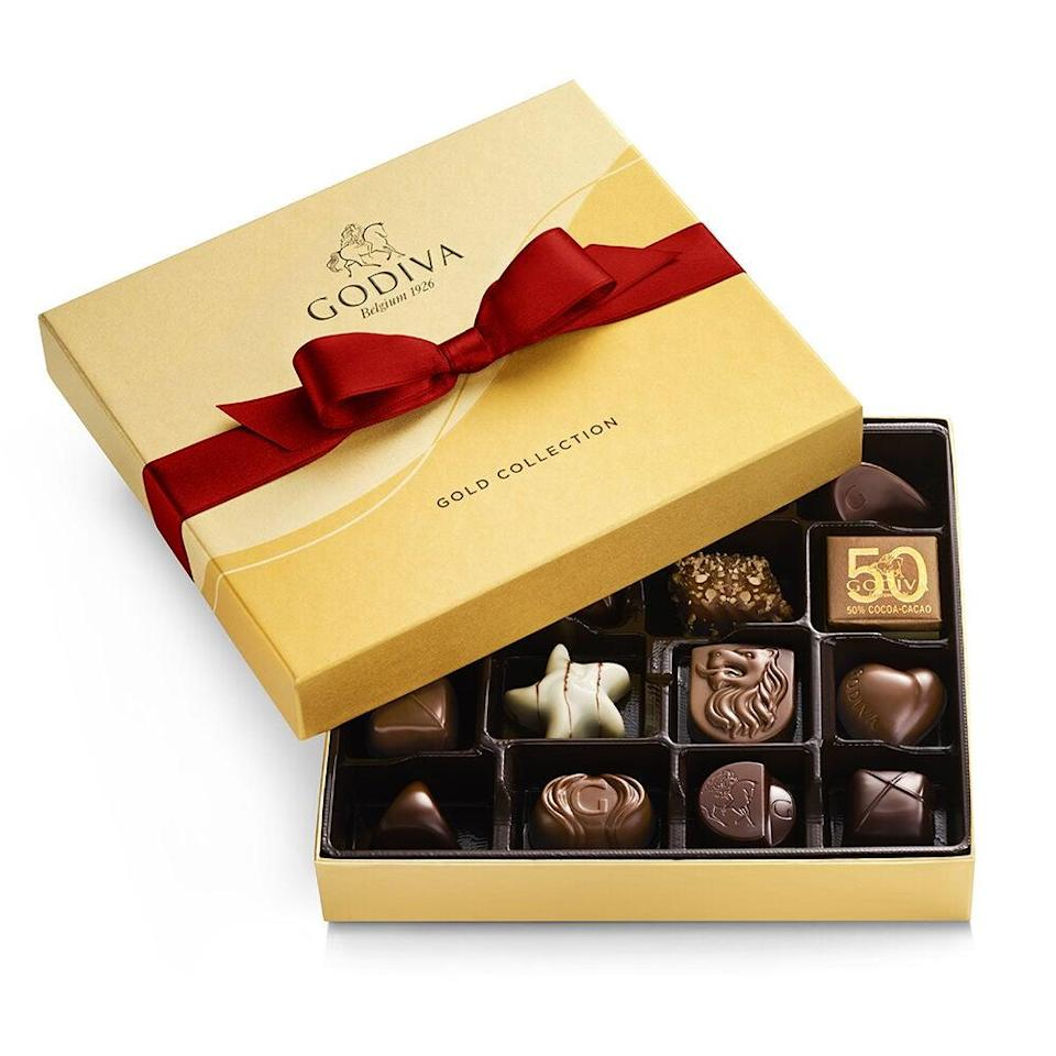"<strong><h3><a href=""https://www.godiva.com/valentines-day-gifts"" rel=""nofollow noopener"" target=""_blank"" data-ylk=""slk:Godiva"" class=""link rapid-noclick-resp"">Godiva</a></h3></strong><br>It's never a bad idea to fall back on reliable-sweet classics during hectic celebration times — and Godiva's bundles of adorably packaged truffles to chocolate-covered pretzels and hot-cocoa mix hits the easily-deliverable mark. <br><br><strong>Godiva</strong> Assorted Chocolate Gold Gift Box, $, available at <a href=""https://go.skimresources.com/?id=30283X879131&url=https%3A%2F%2Fwww.godiva.com%2Fholiday-assorted-chocolate-gold-gift-box-19pc%2F14136.html"" rel=""nofollow noopener"" target=""_blank"" data-ylk=""slk:Godiva"" class=""link rapid-noclick-resp"">Godiva</a>"