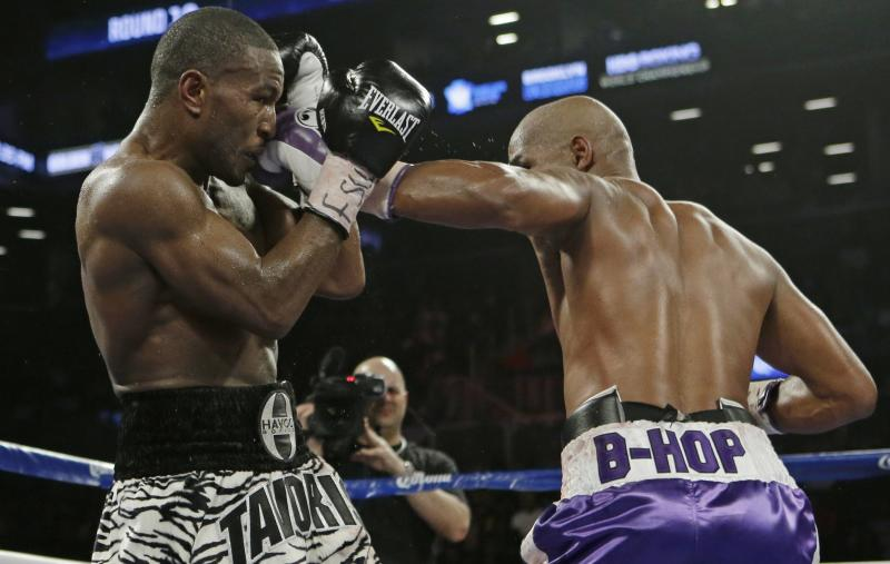 Bernard Hopkins, right,  punches Tavoris Cloud, left, during the 10th round of an IBF Light Heavyweight championship boxing match at the Barclays Center Saturday, March 9, 2013, in New York. Hopkins won by unanimous decision. (AP Photo/Frank Franklin II)