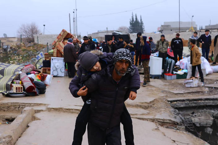 This photo provided on Jan. 30, 2020, by the Northern Democratic Brigade, a group of the US-backed Kurdish-led Syrian democratic forces, shows displaced Syrians fleeing the Syrian military offensive in Idlib province, as they arrive in Manbij town, north Syria. Hundreds of thousands of Syrians have fled recent government bombardment of the last rebel bastion, the northwestern Idlib province, seeking shelter from harsh winter weather in muddy tents and half-constructed buildings. As government forces advance, areas deemed safe are rapidly shrinking. (Northern Democratic Brigade, via AP)