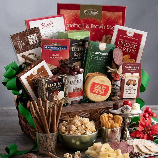"""<p><strong>Gourmet Gift Baskets </strong></p><p>gourmetgiftbaskets.com</p><p><strong>$89.99</strong></p><p><a href=""""https://go.redirectingat.com?id=74968X1596630&url=https%3A%2F%2Fwww.gourmetgiftbaskets.com%2FChristmas-Gift-For-Mom.asp&sref=https%3A%2F%2Fwww.goodhousekeeping.com%2Fholidays%2Fgift-ideas%2Fg34054234%2Fbest-gift-baskets-for-women%2F"""" rel=""""nofollow noopener"""" target=""""_blank"""" data-ylk=""""slk:Shop Now"""" class=""""link rapid-noclick-resp"""">Shop Now</a></p><p>If you're searching for the perfect gift to up her snack stash, look no further than this gift basket. It's filled with gourmet snacks like Belgian chocolates, cookies, and handcrafted popcorn.<br></p>"""