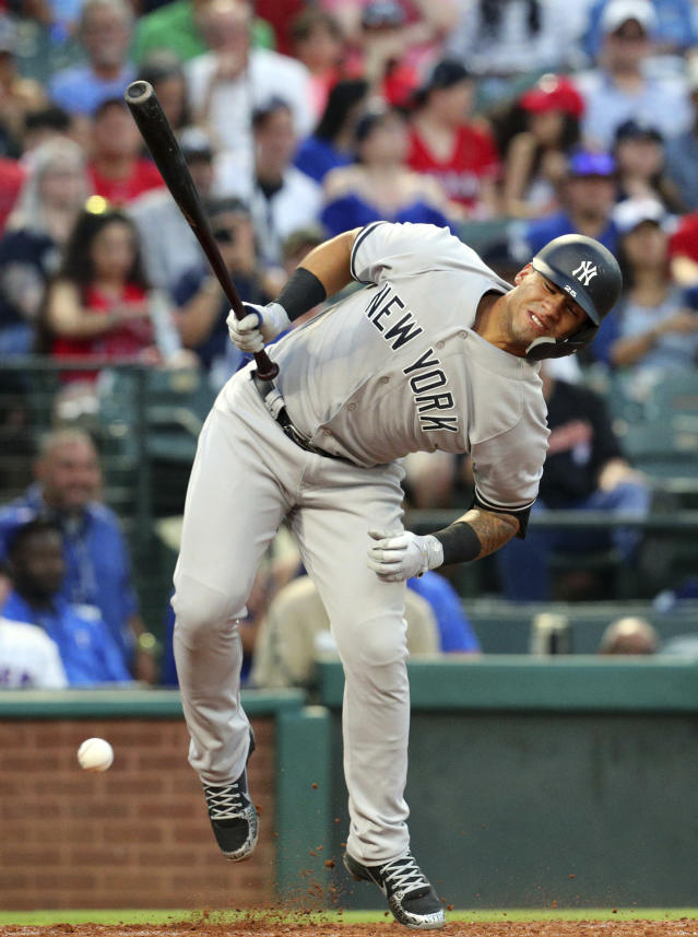 New York Yankees Gleyber Torres (25) reacts after being hit by a pitch in the fourth inning of a baseball game against the Texas Rangers Monday, May 21, 2018, in Arlington, Texas. (AP Photo/Richard W. Rodriguez)