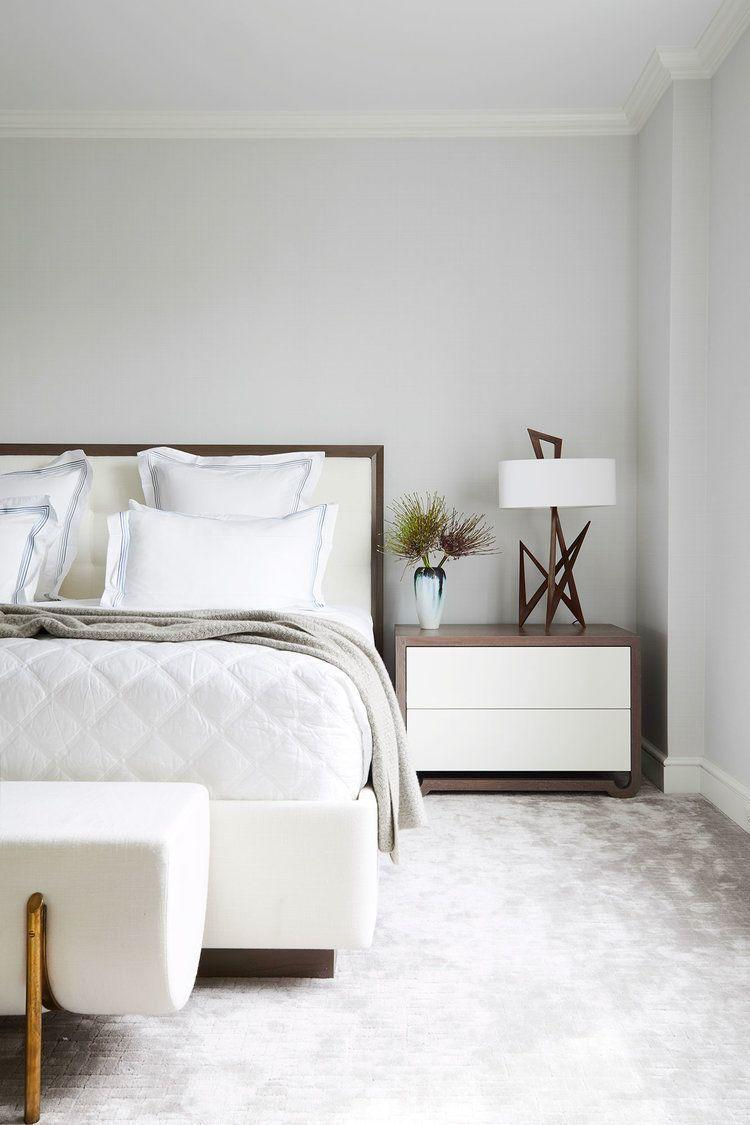 <p>This main bedroom is basically a cloud. The plush, almost glowing carpet makes the whole space feel morel luxe without overwhelming the eye. The end bench and table lamp also introduce great architectural lines. </p>