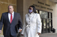 Rochester Mayor Lovely Warren, right, and her attorney Joe Damelio, left, walk to city court for arraignment in Rochester, N.Y., Monday, Oct. 5, 2020. Warren, who has faced calls to resign over her city's handling of the suffocation death of Daniel Prude at the hands of police, pleaded not guilty Monday to campaign finance charges dating to her 2017 reelection campaign. (AP Photo/Adrian Kraus)