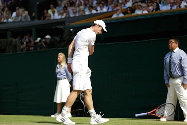 LONDON, ENGLAND - JULY 07: Andy Murray of Great Britain throws his racquet to the ground during the Gentlemen's Singles Final match against Novak Djokovic of Serbia on day thirteen of the Wimbledon Lawn Tennis Championships at the All England Lawn Tennis and Croquet Club on July 7, 2013 in London, England. (Photo by Anja Niedringhaus - Pool/Getty Images)
