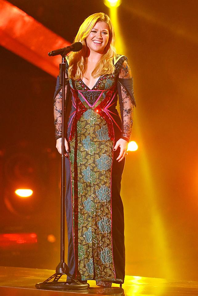 """LOS ANGELES, CA - DECEMBER 16: Kelly Clarkson performs onstage at the """"VH1 Divas"""" show held at The Shrine Auditorium on December 16, 2012 in Los Angeles, California. (Photo by Michael Tran/FilmMagic)"""