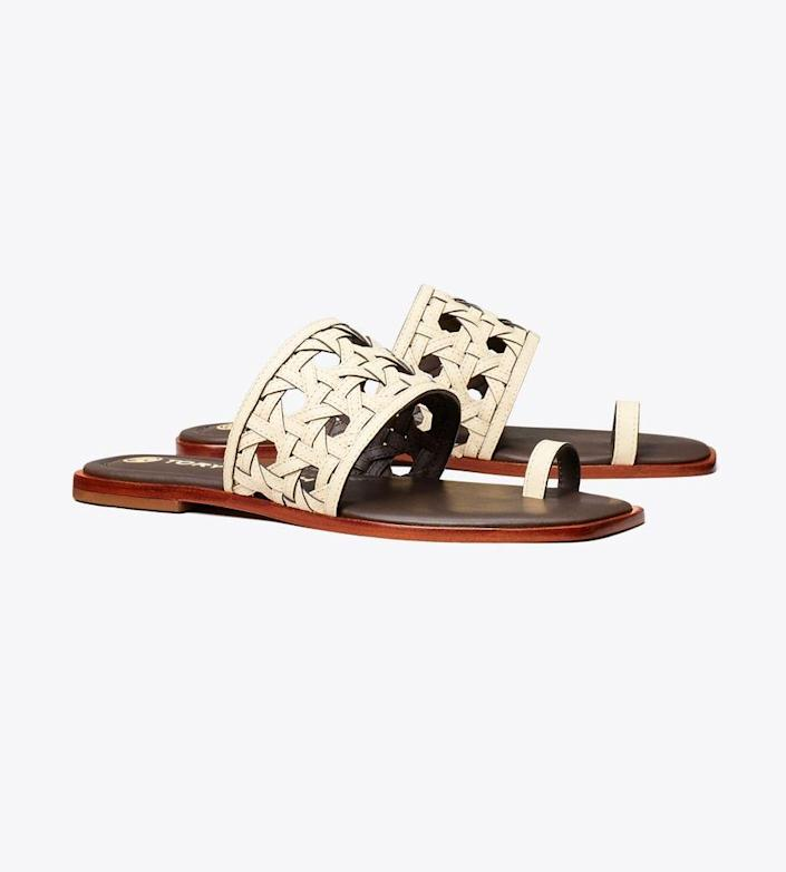 """<p><strong>Tory Burch </strong></p><p>toryburch.com</p><p><strong>$258.00</strong></p><p><a href=""""https://go.redirectingat.com?id=74968X1596630&url=https%3A%2F%2Fwww.toryburch.com%2Fen-us%2Fshoes%2Fsandals%2Fbasket-weave-slide%2F81729.html&sref=https%3A%2F%2Fwww.veranda.com%2Ftravel%2Fg37080014%2Ftravel-essentials%2F"""" rel=""""nofollow noopener"""" target=""""_blank"""" data-ylk=""""slk:Shop Now"""" class=""""link rapid-noclick-resp"""">Shop Now </a></p><p>How to beat the airport rush: Don't wear sneakers through security. The summer's most stylish sandal is the best way to beat the airport blues. </p>"""