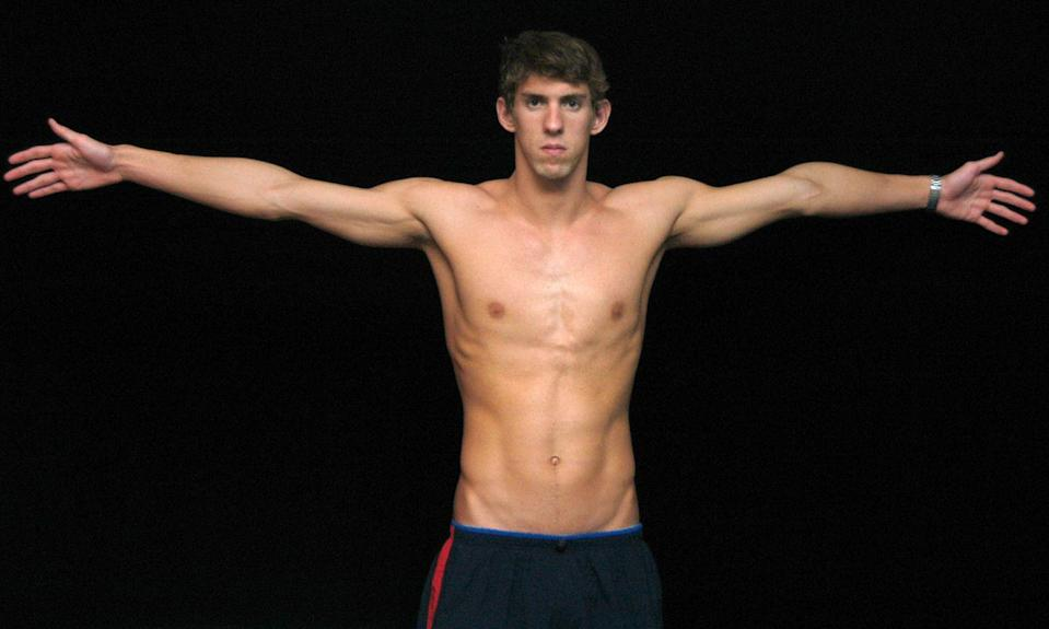 """<p>Ahead of the 2004 Olympic Games, Michael Phelps' extreme wingspan was touted in the press. His proportions are <a href=""""https://www.biography.com/news/michael-phelp-perfect-body-swimming"""" rel=""""nofollow noopener"""" target=""""_blank"""" data-ylk=""""slk:three inches longer than his height"""" class=""""link rapid-noclick-resp"""">three inches longer than his height</a> from fingertip to fingertip, earning him the nickname """"Flying Fish.""""</p>"""