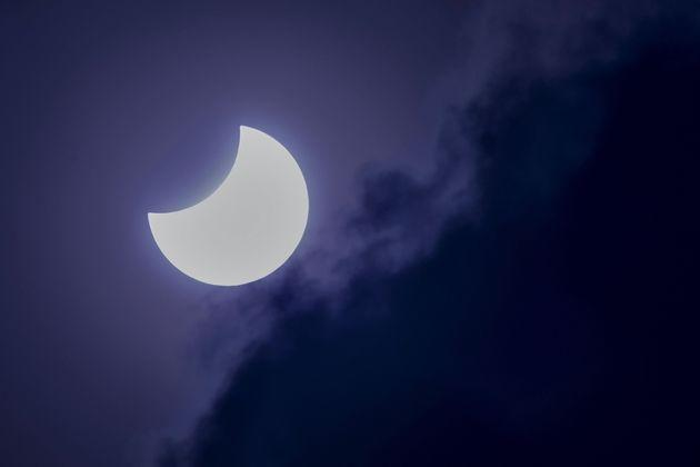 The moon partially covers the sun during an annular solar eclipse as seen from Bangalore on June 21, 2020.