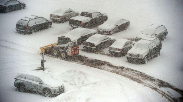 PHOTO: A snowplow makes its way past snow-covered cars in a parking lot in St. Paul, Minn., March 5, 2018.  (Neal Lambert/Pioneer Press via AP)