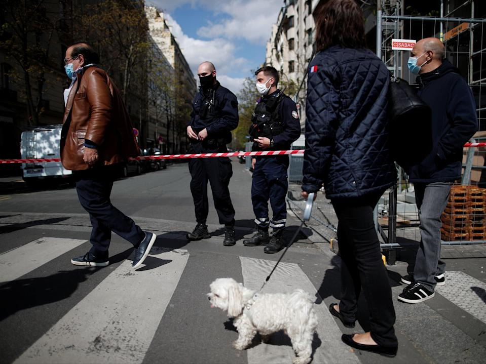 French police secure the area after one person was shot dead and one injured in front of the Henry Dunant hospital in ParisReuters