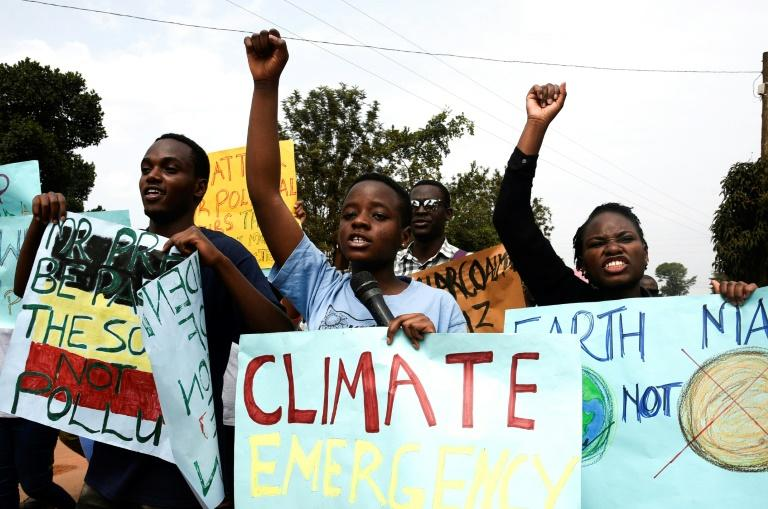 Young people took part in a march against climate change (AFP Photo/ISAAC KASAMANI)