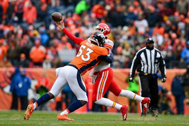 <p>Quarterback Patrick Mahomes #15 of the Kansas City Chiefs is hit by linebacker Deiontrez Mount #53 of the Denver Broncos as he attempts a pass int he first quarter of a game at Sports Authority Field at Mile High on December 31, 2017 in Denver, Colorado. (Photo by Dustin Bradford/Getty Images) </p>