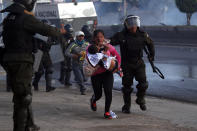 """Police detain backers of former President Evo Morales on the outskirts of Cochabamba, Bolivia, Saturday, Nov. 16, 2019. Officials now say at least eight people died when Bolivian security forces fired on Morales supporters the day before, in Sacaba. The U.N. human rights chief says she's worried that Bolivia could """"spin out of control"""" as the interim government tries to restore stability following the resignation of the former president in an election dispute. (AP Photo/Juan Karita)"""
