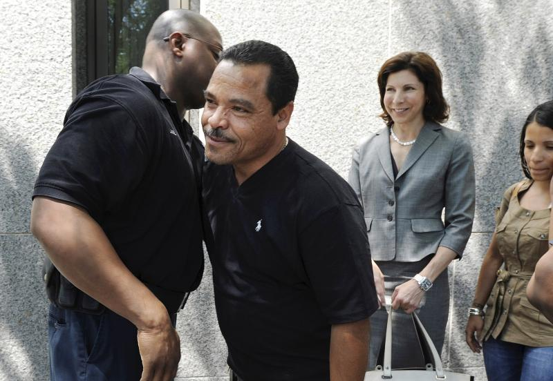 FILE - In this July 22, 2011 file photo, Miguel Roman, center, hugs a corrections officer at Superior Court, in Hartford, Conn., after Pedro Miranda was sentenced to life in prison for the murder of Roman's girlfriend, Carmen Lopez. Roman had served almost two decades in prison for her killing before being freed in 2008 based on new DNA evidence. Several states have moved to toughen regulations on the use of jailhouse informants. Advocates said Roman's erroneous conviction was based in part on the testimony of lying inmates. (AP Photo/Jessica Hill, File)