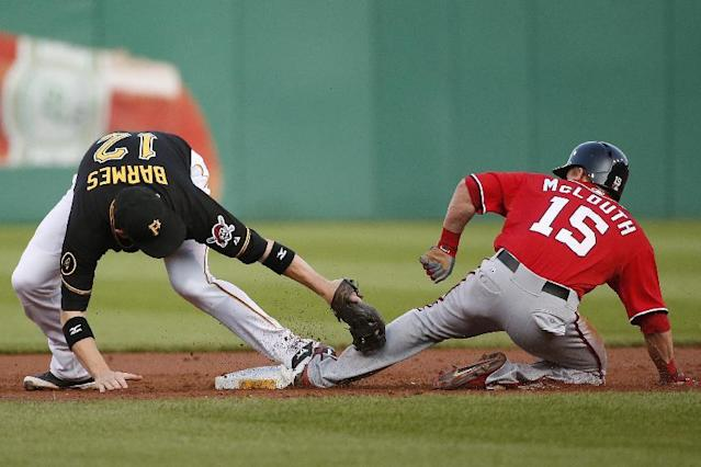 Washington Nationals' Nate McLouth (15) gets his foot to the second base bag before the tag by Pittsburgh Pirates shortstop Clint Barmes (12) for a stolen base during the fourth inning of a baseball game in Pittsburgh, Saturday, May 24, 2014. (AP Photo/Gene J. Puskar)