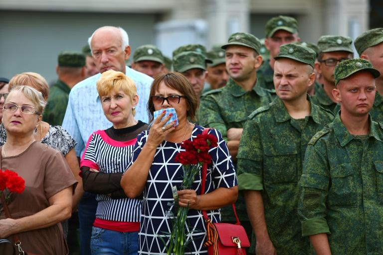 Tens of thousands of mourners lined the streets of Donetsk to pay their respects to the assassinated east Ukraine rebel leader Alexander Zakharchenko