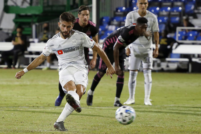 FILE - Los Angeles FC forward Diego Rossi (9) scores on a penalty kick against the Seattle Sounders during the first half of an MLS soccer match in Kissimmee, Fla., in this Monday, July 27, 2020, file photo. Nobody was better at finding the back of the net than Diego Rossi of Los Angeles FC a season ago. (AP Photo/Reinhold Matay, File)