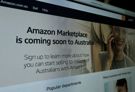FILE PHOTO: A web page featuring Amazon's Australian URL is pictured in this photo illustration in a Sydney office, Australia, April 20, 2017.   REUTERS/Jason Reed/Illustration Photo/File Photo