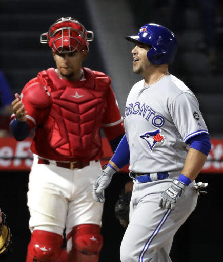 Toronto Blue Jays' Steve Pearce celebrates his three-run home run next to Los Angeles Angels catcher Jose Briceno during the ninth inning of a baseball game in Anaheim, Calif., Saturday, June 23, 2018. (AP Photo/Chris Carlson)