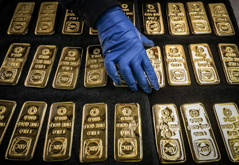 A worker handles ABC Bullion one kilogram gold bars at the ABC Refinery smelter in Sydney, New South Wales, Australia, on Thursday, July 2, 2020. (Photographer: David Gray/Bloomberg)