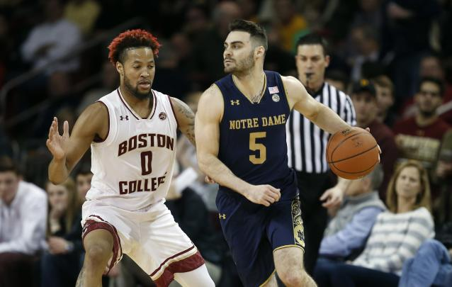 Boston College's Ky Bowman (0) defends against Notre Dame's Matt Farrell (5) during the first half of an NCAA college basketball game in Boston. (AP)