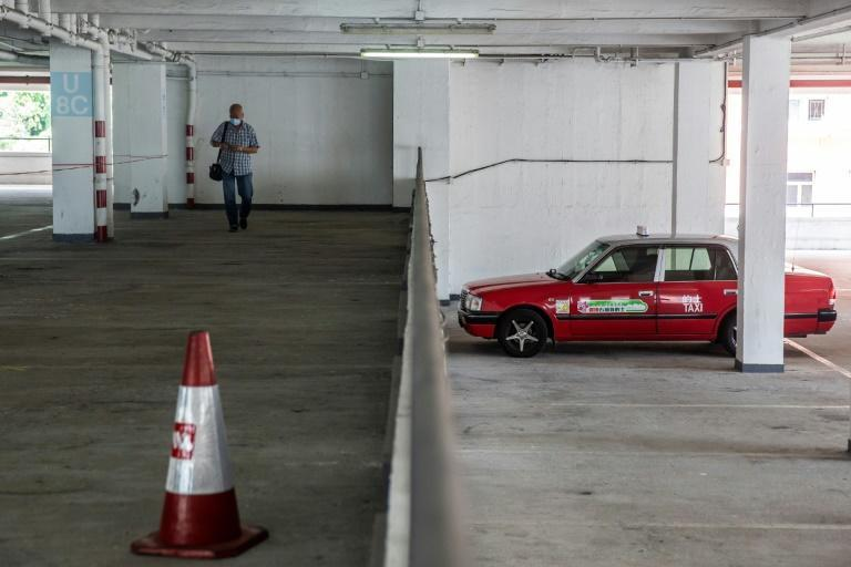 A taxi driver arrives to get tested for the coronavirus at a makeshift testing station in Hong Kong
