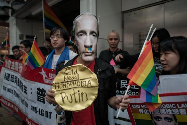 An activist wearing a mask of Russian President Vladimir Putin joins protesters against Russia's anti-gay legislation on the day of the opening ceremony the Sochi Winter Olympic Games in Hong Kong onFeb.7, 2014 (PHILIPPE LOPEZ via Getty Images)