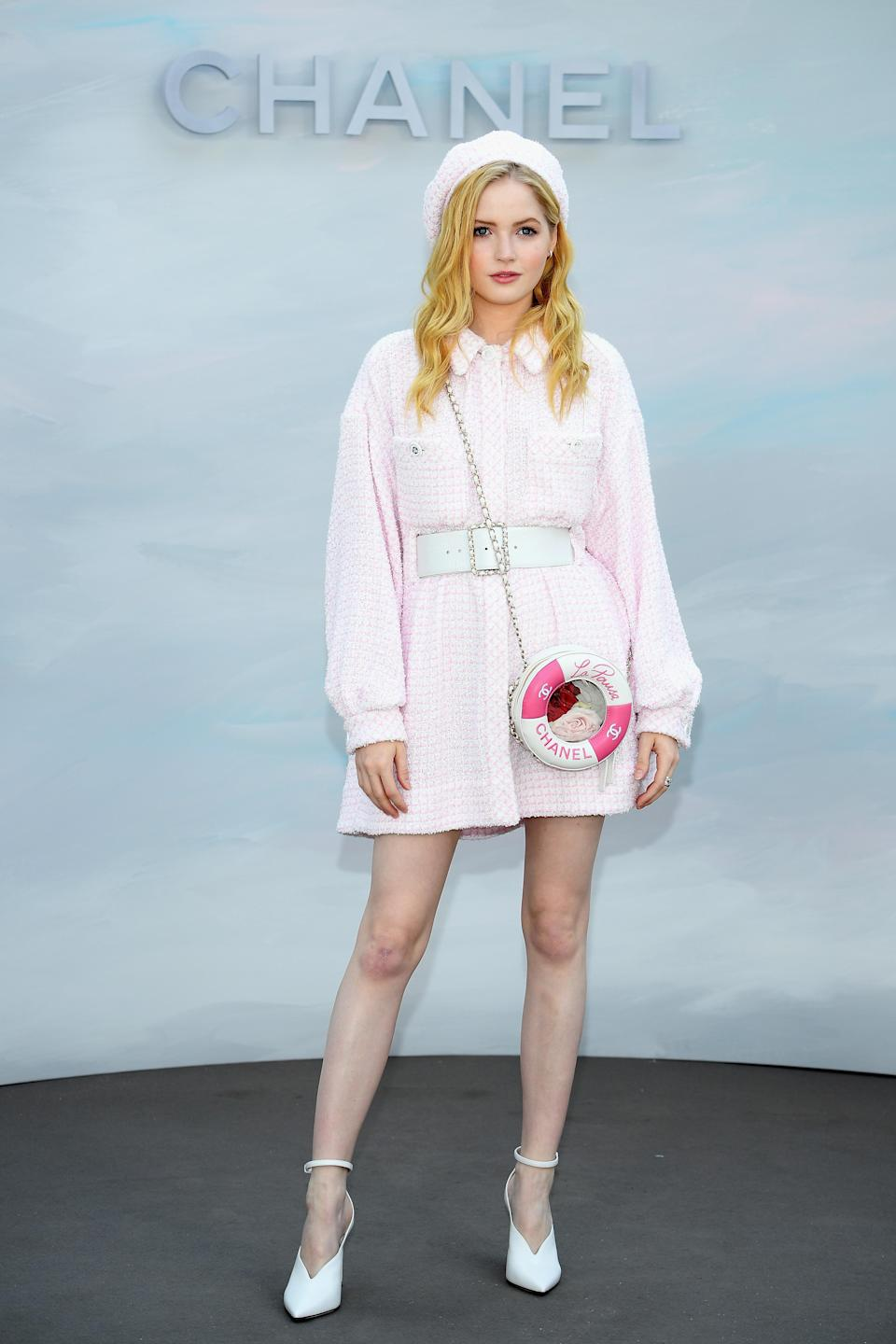 <p>For the Chanel haute couture show in Paris, actress Ellie Bamber donned a beret and powder pink dress by the Parisian label. <em>[Photo: Getty]</em> </p>