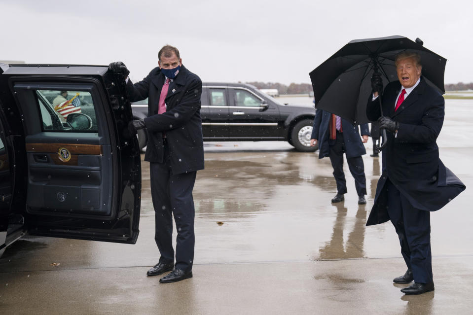 President Donald Trump arrives at Oakland County International Airport, Sunday, Nov. 1, 2020, in Waterford Township, Mich. (AP Photo/Evan Vucci)