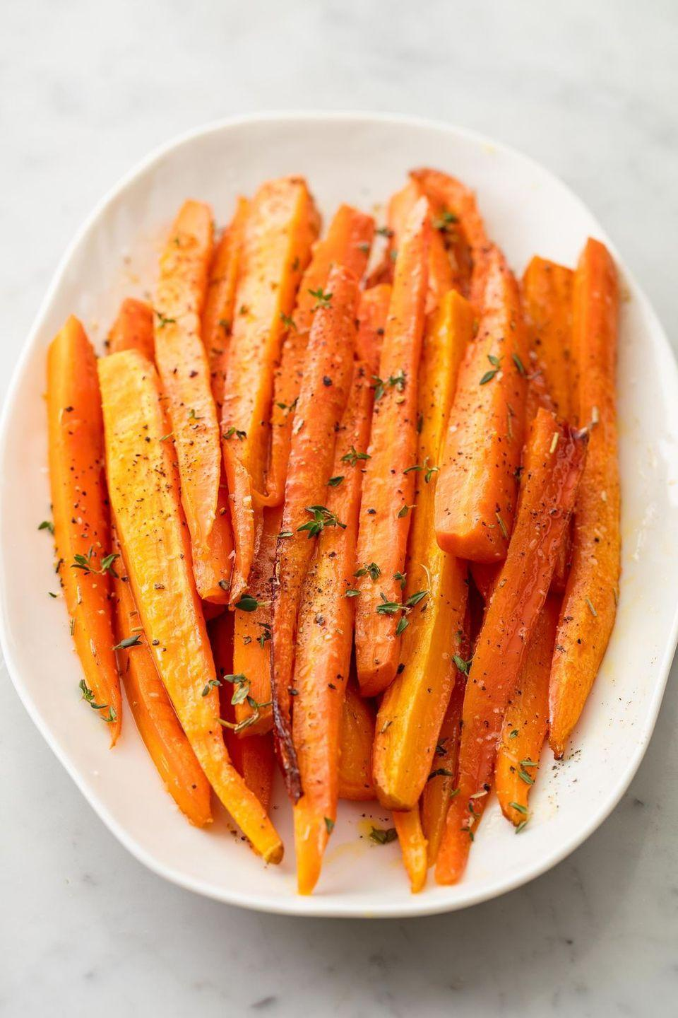 """<p>How do you show picky eaters how delicious vegetables can be? The answer is two-part: First, you make a sweet and sticky glaze; then, you roast. in the oven, the honey butter caramelises and turns plain, boring carrots into the most addictive side dish. Don't have dried rosemary? Use dried oregano instead. Not into thyme? Just skip it. This dish is pretty much impossible to screw up.</p><p>Get the <a href=""""https://www.delish.com/uk/cooking/recipes/a28934289/honey-glazed-carrots-recipe/"""" rel=""""nofollow noopener"""" target=""""_blank"""" data-ylk=""""slk:Honey-Glazed Carrots"""" class=""""link rapid-noclick-resp"""">Honey-Glazed Carrots </a>recipe.</p>"""