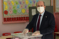 Ersin Tatar, candidate and prime minister of a self-declared Turkish Cypriot state recognized only by Turkey, casts his ballot at a polling station in the Turkish occupied area in the north part of the divided capital Nicosia, Cyprus, Sunday, Oct. 18, 2020. Turkish Cypriots are voting in a leadership runoff to chose between an incumbent who pledges a course less bound by Turkey's dictates and a challenger who favors even closer ties to Ankara. (AP Photo/Nedim Enginsoy)