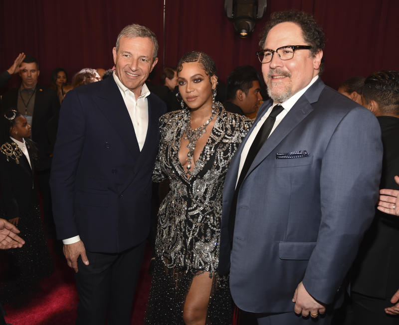 "Bob Iger, left, chairman and CEO of The Walt Disney Company, poses with ""The Lion King"" cast member Beyonce, center, and the film's director Jon Favreau at the premiere of the film at the El Capitan Theatre, Tuesday, July 9, 2019, in Los Angeles. (Photo by Chris Pizzello/Invision/AP)"