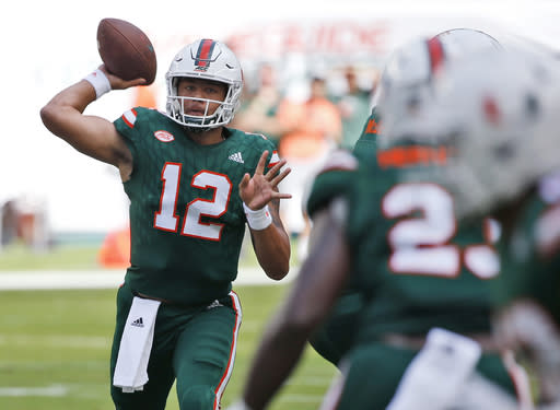 Miami quarterback Malik Rosierthrows a pass during the first half against Syracuse. (AP Photo)