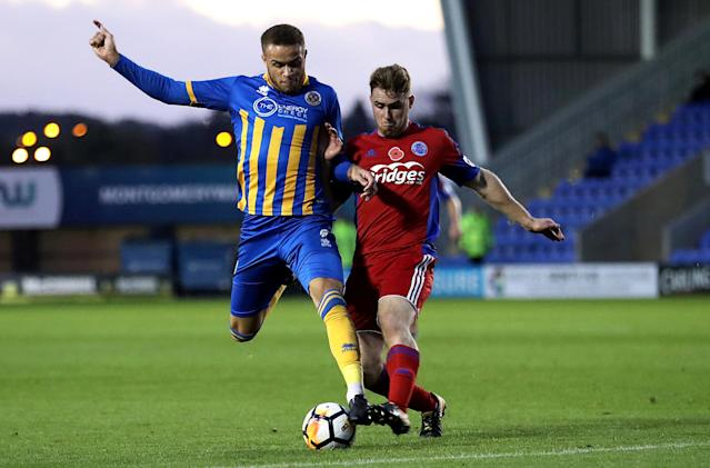 Soccer Football - FA Cup First Round - Shrewsbury Town vs Aldershot Town - New Meadow, Shrewsbury, Britain - November 4, 2017 Shrewsbury Town's Carlton Morris is tackled by Aldershot Town's George Fowler Action Images/John Clifton