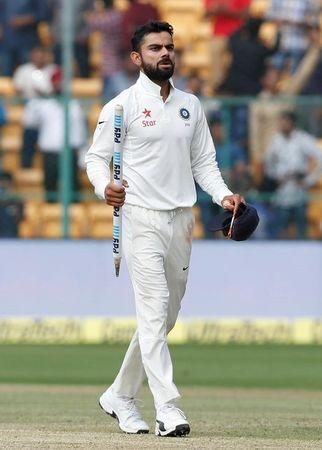 Cricket - India v Australia - Second Test cricket match - M Chinnaswamy Stadium, Bengaluru, India - 07/03/17 - India's captain Virat Kohli walks off the ground after winning the match. REUTERS/Danish Siddiqui