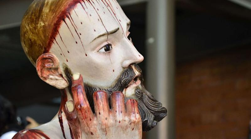 The institute suspects the teeth were donated by a parishioner when the work was being made. The restored Lord of Patience figure is housed at the San Bartolo Cuautlalpan Temple, in Zumpango, just north of Mexico City. Photo: Reuters