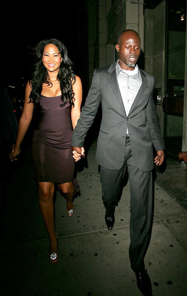 "Kimora Lee Simmons and Djimon Hounsou walk hand in hand on their way to club Butter. Ahmad Elatab/Jackson Lee/<a href=""http://www.splashnewsonline.com/"" target=""new"">Splash News</a> - September 10, 2007"