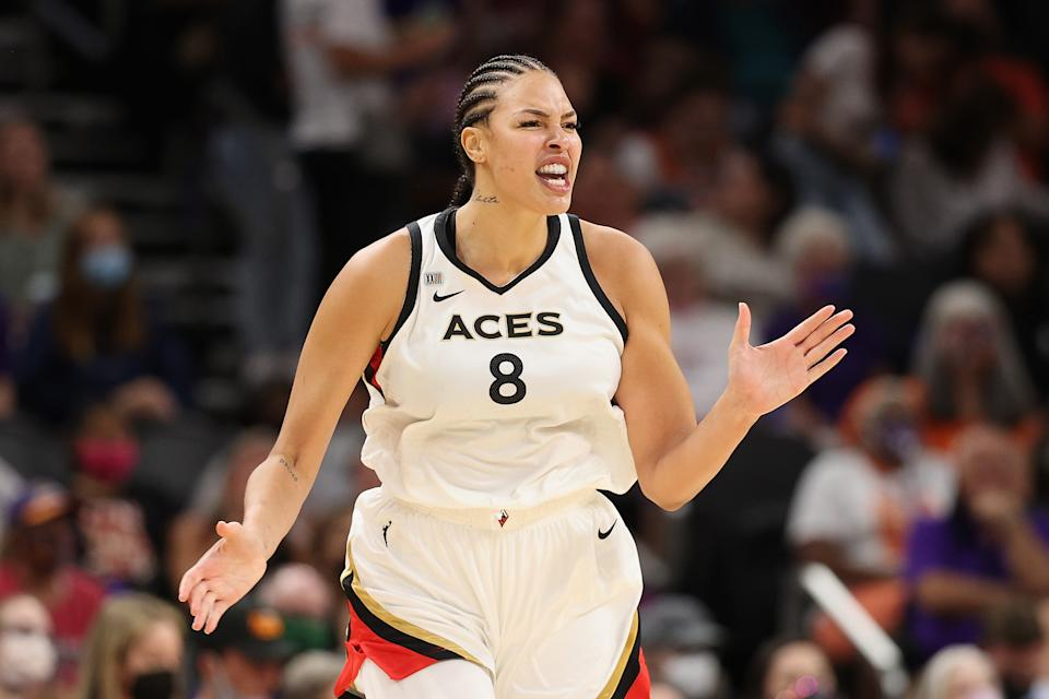 Las Vegas Aces center Liz Cambage celebrates after a 3-point shot against the Phoenix Mercury in Game 4 of the 2021 WNBA semifinals at Footprint Center in Phoenix on Oct. 6, 2021. The Aces defeated the Mercury 93-76 to even the series and force a decisive Game 5. (Christian Petersen/Getty Images)
