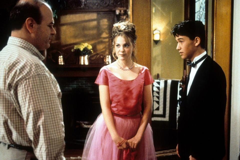 """<p>Much to her father's chagrin, Bianca wore a pink satin crop top paired with a tulle skirt that showed off a hint of her belly button. Note the incredibly '90s hairstyle. </p><p><a class=""""link rapid-noclick-resp"""" href=""""https://www.amazon.com/gp/video/detail/B00FY8ARI8/?tag=syn-yahoo-20&ascsubtag=%5Bartid%7C10063.g.36197518%5Bsrc%7Cyahoo-us"""" rel=""""nofollow noopener"""" target=""""_blank"""" data-ylk=""""slk:STREAM NOW"""">STREAM NOW</a></p>"""