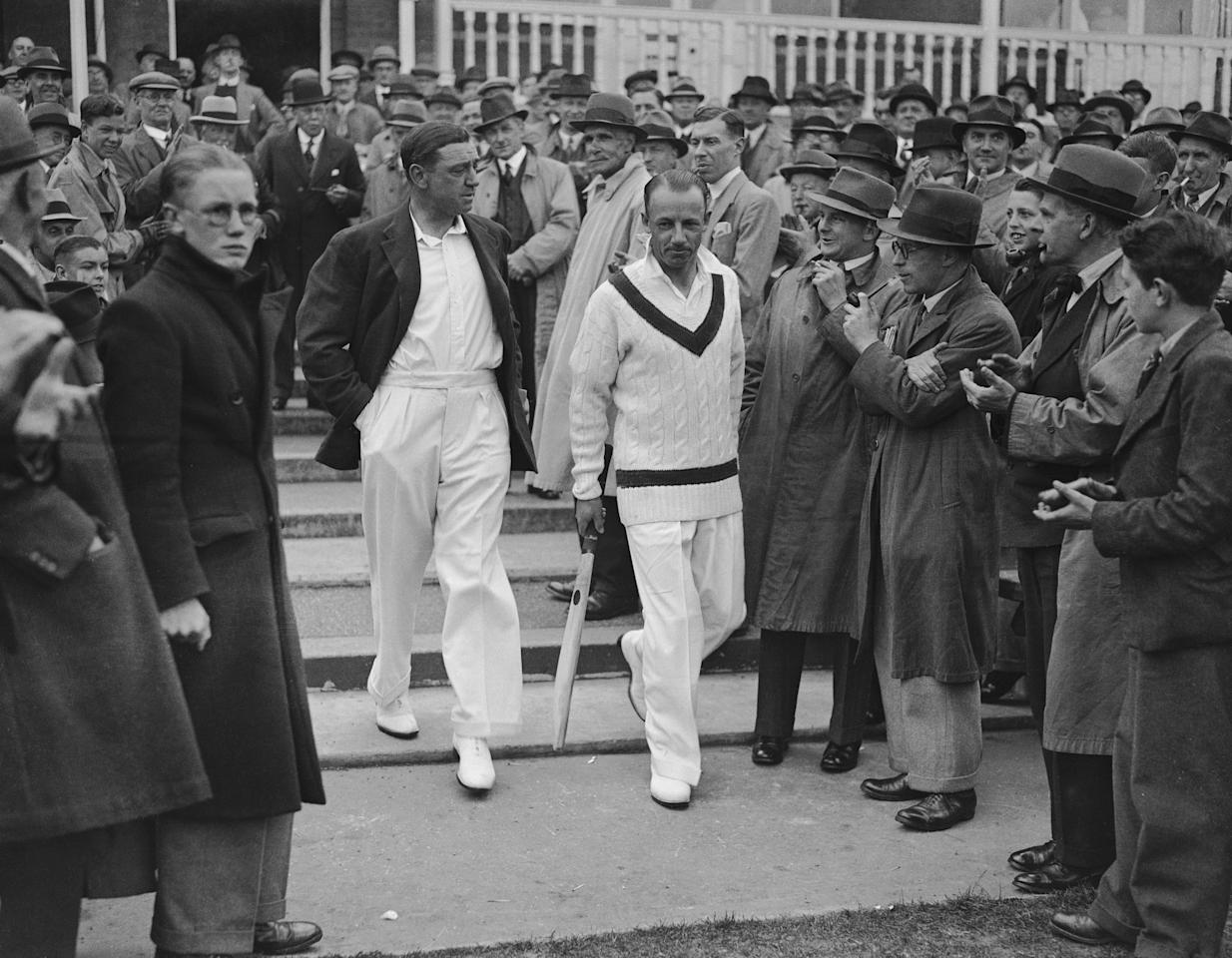 1st June 1938: English cricketer Walter 'Wally' Hammond (1903 - 1965) and Australian cricketer Sir Don Bradman (1908 - 2001) going on for the toss in the first England v Australia test match at Trent Bridge, Nottingham, England. Sir Donald Bradman was the first cricketer to be knighted in 1949 for his services to cricket. (Photo by Central Press/Getty Images)