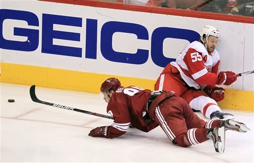 Detroit Red Wings' Niklas Kronwall (55), of Sweden, collides with Phoenix Coyotes' Mikkel Boedker, of Denmark, during the second period in an NHL hockey game Monday, Feb. 6, 2012, in Glendale, Ariz.(AP Photo/Ross D. Franklin)