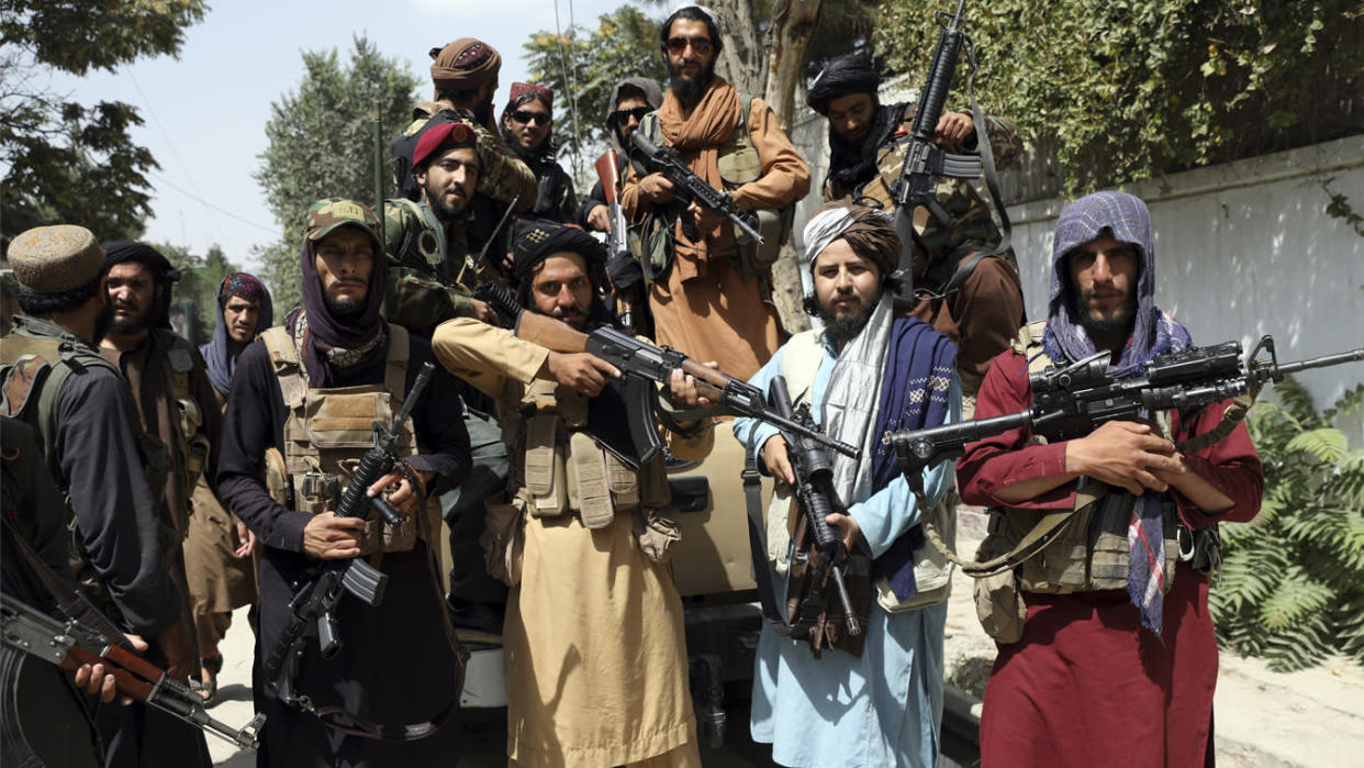 Taliban fighters pose for a photograph in Kabul, Afghanistan, Thursday, Aug. 19, 2021. (Rahmat Gul/AP Photo)