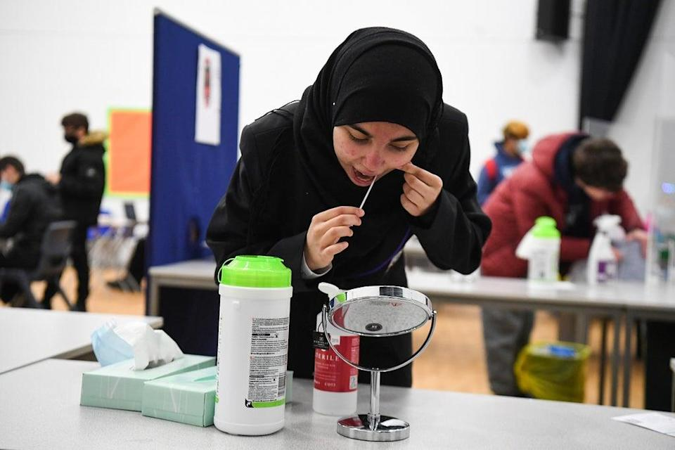 A student takes a Lateral Flow Test at Hounslow Kingsley Academy in West London (PA) (PA Wire)