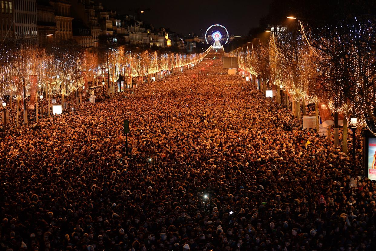 New Year revelers gather on the Champs-Elysees avenue in Paris on December 31, 2017. (Photo: GUILLAUME SOUVANT via Getty Images)