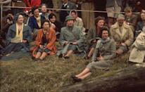<p>The Queen and the Queen mother sit on the grass to watch the Badminton Horse Trials.</p>