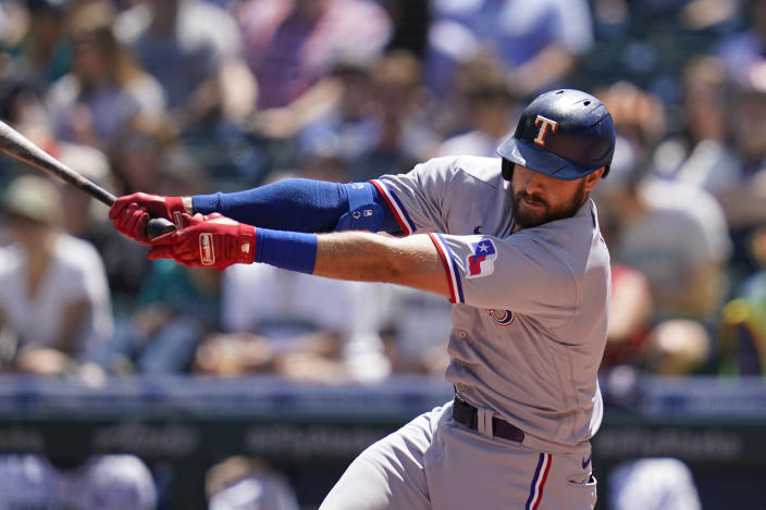 Texas Rangers' Joey Gallo swings and misses to strike out against the Seattle Mariners in the second inning of a baseball game Sunday, July 4, 2021, in Seattle. (AP Photo/Elaine Thompson)