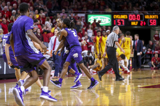 Kansas State guard Barry Brown Jr. is hugged by teammate Kansas State guard Cartier Diarra after hitting the game winning basket last in the second half of their 58-57 victory over Iowa State during an NCAA college basketball game, Saturday, Jan. 12, 2019, in Ames, Iowa. (AP Photo/Justin Hayworth)