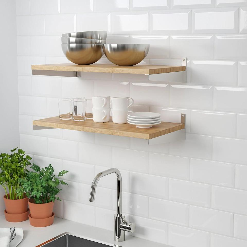 "<p>Mount the <a href=""https://www.popsugar.com/buy/Kungsfors%20Shelf-446985?p_name=Kungsfors%20Shelf&retailer=ikea.com&price=20&evar1=casa%3Aus&evar9=46151613&evar98=https%3A%2F%2Fwww.popsugar.com%2Fhome%2Fphoto-gallery%2F46151613%2Fimage%2F46152174%2FKungsfors-Shelf&list1=shopping%2Cikea%2Corganization%2Ckitchens%2Chome%20shopping&prop13=api&pdata=1"" rel=""nofollow noopener"" target=""_blank"" data-ylk=""slk:Kungsfors Shelf"" class=""link rapid-noclick-resp"">Kungsfors Shelf</a> ($20) onto the kitchen wall and enjoy easy accessibility to plates, cups, and bowls.</p>"